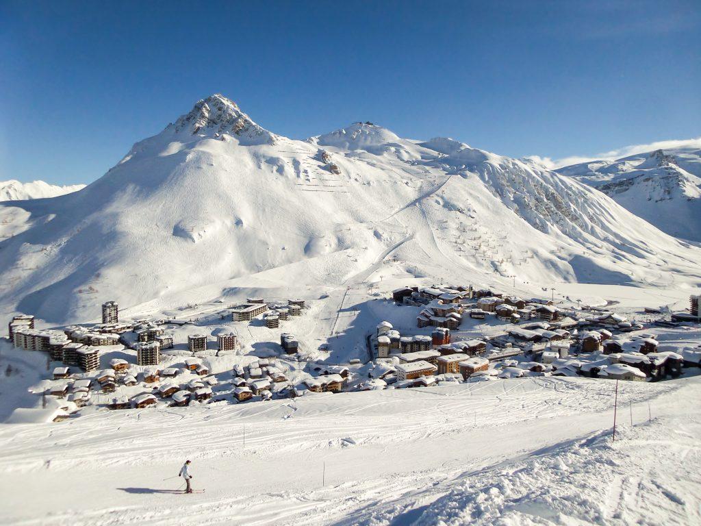 Ski resort of Tignes in winter, ski slope and village of Tignes le lac in the background